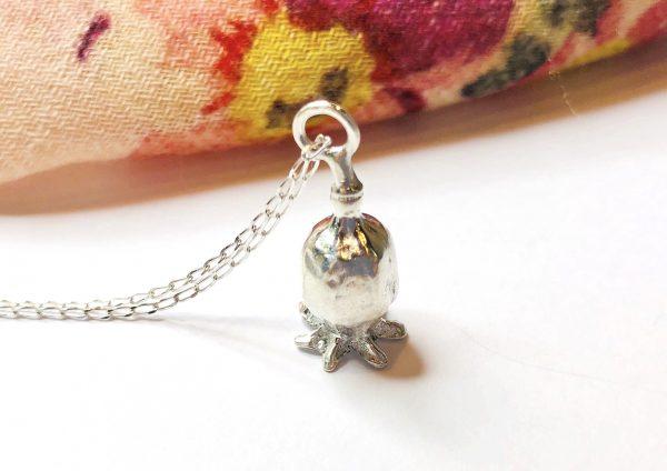silver poppy on chain