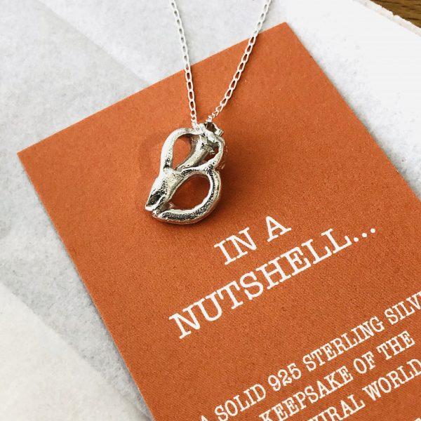 silver heart shell back of pendant