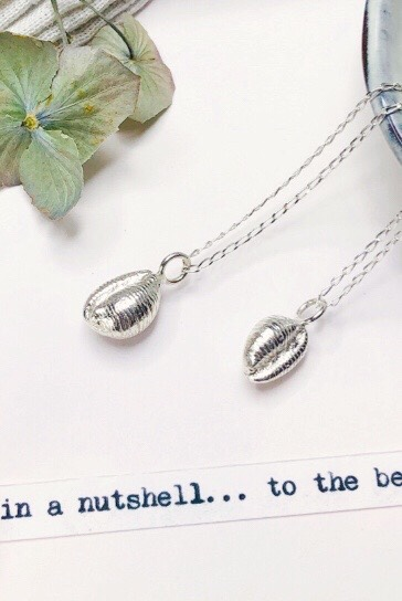 silver cowrie shell charms on chains make beautiful gifts