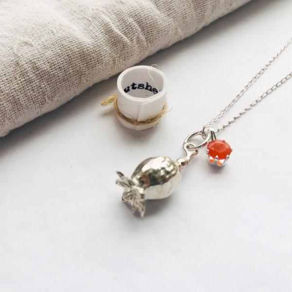 silver poppy with orange carnelian gemstone