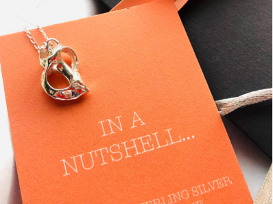 silver nutshell brand card with heart shell necklace
